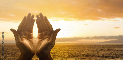 Fototapeta Hands together praying in bright sky