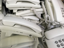 Close Up Of Unused White Telephones Waiting For Scrapping