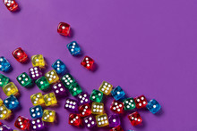 Bright And Colorful Dice Set On Violet Background