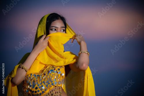 Photo Portrait of asian beautiful sexy woman wear in arab costume,Princess of desert c