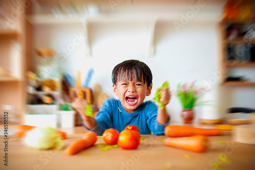 Photo The boy who shows anger in the kitchen