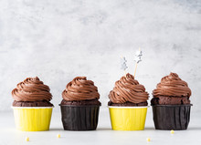 Chocolate Cupcakes In Yellow P...