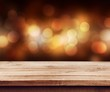 Party bokeh background and a wooden board