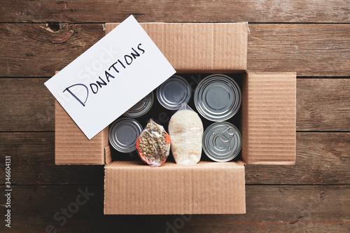 a donation box full of food items. Wallpaper Mural