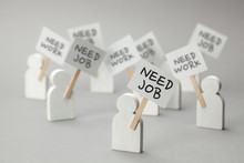 Need Job. Crowd Of Unemployed People With Posters On Gray Background