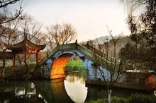 Footbridge Over River In Park