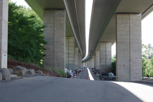 Parking Under The Bridge In The City. Parking In The City, Reinforced Concrete Structures Of The Overpass