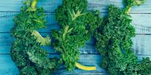 Fresh Curly Kale Leaves On Woo...