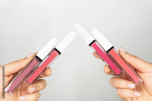 Valokuva Set of pastel lip gloss in tube template