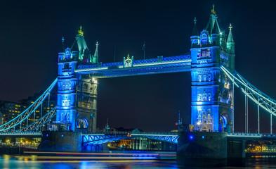 Illuminated Tower Bridge Over Thames River At Night