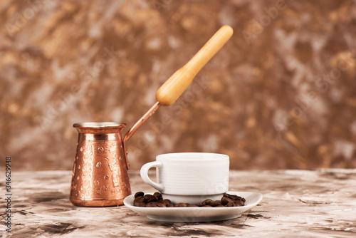 Fototapeta Coffee beans saucer, white coffee cup and cezve. obraz