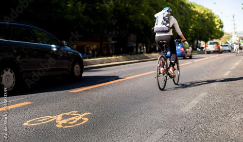 Bicycle lane and car traffic Wallpaper Mural