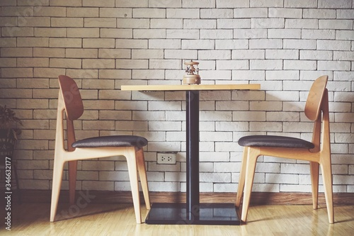 Obraz Chairs And Table At Cafe - fototapety do salonu