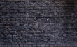 Old wall of stone bricks as a texture or background