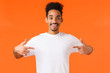 canvas print picture - Optimistic happy and cute african-american hipster guy, want make a change, volunteer, willing participate, pointing himself telling he is one, perfect candidate, standing orange background