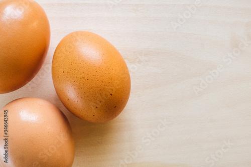 Brown Eggs on Cedar Background