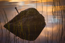 Scenic Reflection Of Rock In Calm Lake