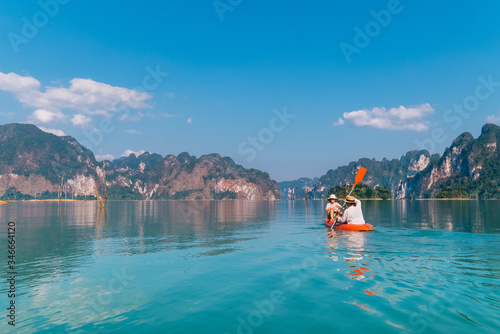 Mother with son together floating on kayak by the Cheow Lan lake in exotic Thailand Canvas-taulu