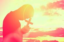 Silhouette Boy Holding Cross A...