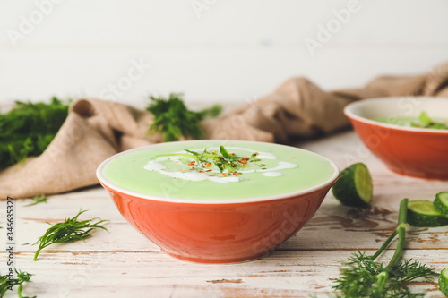 Fototapeta Bowl with cold cucumber soup on table obraz