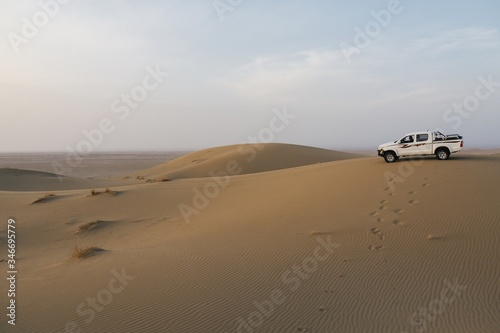 White safari car in the Varzaneh desert, Iran