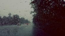 Street Seen Through Wet Glass Window During Monsoon