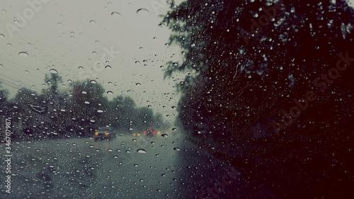 Foto Street Seen Through Wet Glass Window During Monsoon