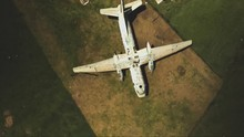 Aerial View Of An Abandoned Plane In The Caribbean, Parallax Rotation Downwards