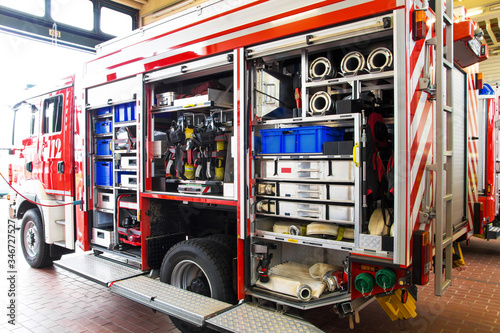 Firefighting equipment in a fire truck with the vehicle garage open at the main Canvas Print