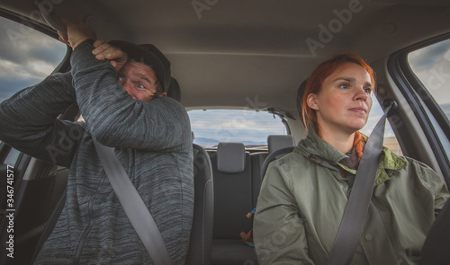 A woman is calmly driving a car and a man in the next seat is scared as hell Принти на полотні