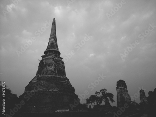 Low Angle View Of Temple At Ayuthaya Province Against Cloudy Sky Canvas Print