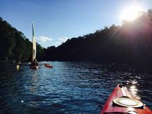 Kayak In Rocky Gorge Reservoir Against Sky On Sunny Day