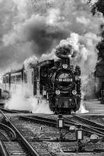 Steam Train On Railroad Tracks