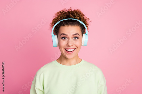 Vászonkép Portrait of astonished positive cheerful teenager girl listen wireless headset f