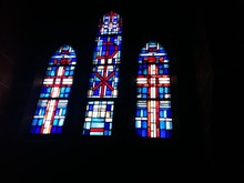 Low Angle View Of Stained Glass Windows In Church
