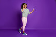 canvas print picture - Full length profile side photo of positive teen afro american break pause use smart phone browse popular songs wear headset listen music have pink trousers isolated violet color background