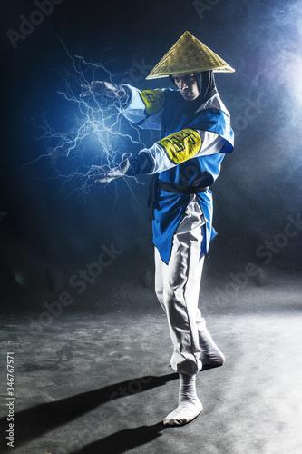 Fotografie, Obraz Cosplay Raiden Mortal Kombat on a black background