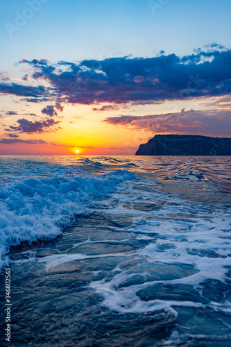 Obraz Raging sea waves at sunset in the ocean. Storm clouds on the sea. - fototapety do salonu