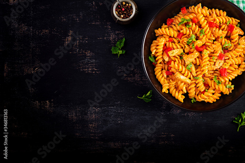 Fusilli pasta with chicken and sweet pepper in tomato sauce Fototapeta