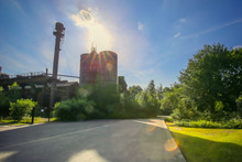 Smoke Stack At Industrial Building On Sunny Day