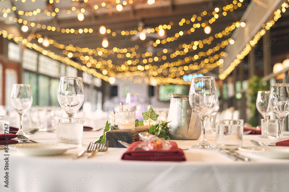 Fototapeta table set on a catering, banquet or wedding with bokeh light balls and chocolate