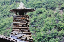 Stone Chimney On Roof Against ...