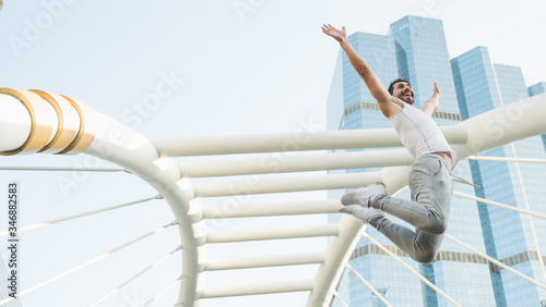 Young handsome sport man jumping training outdoors healthy lifestyle and sport concept Wallpaper Mural