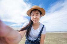 Asian Woman Take Selfie On Cam...