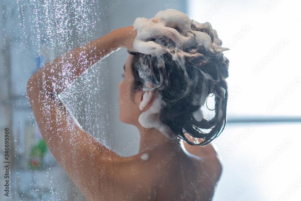 Fototapeta Asian woman washing hair and showering
