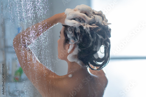 Asian woman washing hair and showering