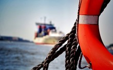 Close-up Of Life Belt And Rope Against Sky At Sea
