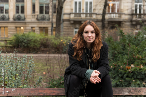 Photo Young Caucasian Woman Sitting on Park Bench Backrest
