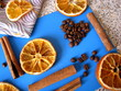 Dried oranges, coffee beans and cinnamon on a blue Board and a towel.