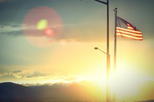 American Flag Against Sky During Sunset
